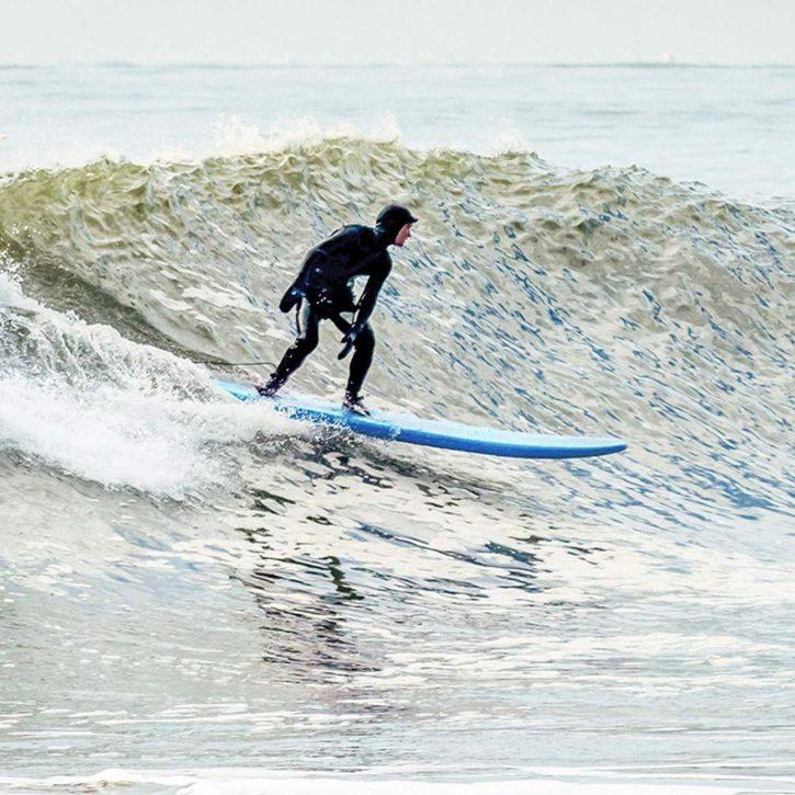 Kona Malibu Surfboard on a wave
