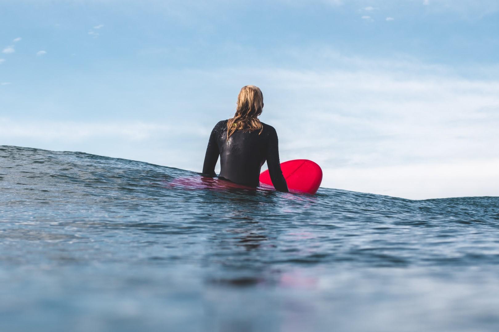 Surfer in water on surfboard