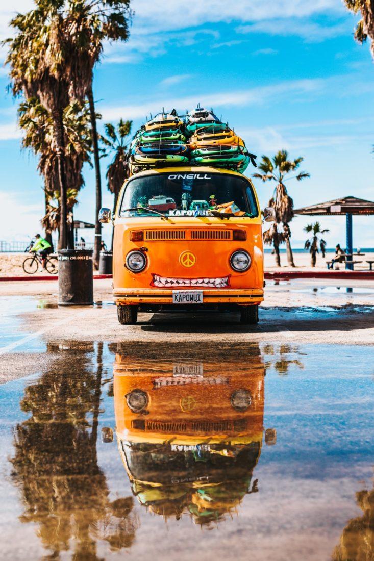 VW Van with lots of surfboards